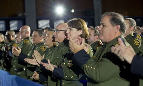Border Patrol Officers applaud as President Donald Trump is introduced before speaking at the Homeland Security Department Jan. 25.