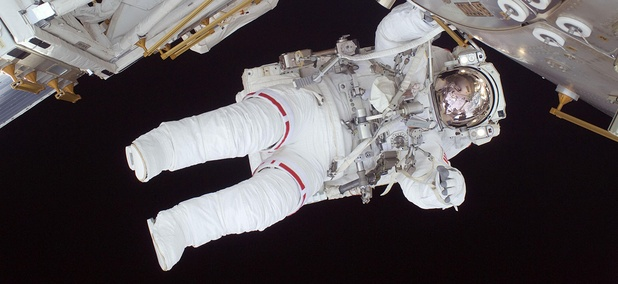 Astronaut Nicole Stott participates in the STS-128 mission's first spacewalk as construction and maintenance continue on the International Space Station in 2015.