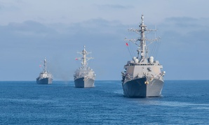 guided-missile destroyers USS Pinckney, USS Howard and USS Shoup steam in formation behind the guided-missile cruiser USS Princeton in March.