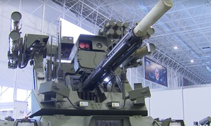 "An armed ground tank robot called the Vikhr, or ""Whirlwind,"" on display at the 2nd annual Military & Scientific Robotic Conference at Patriot Center in Moscow."