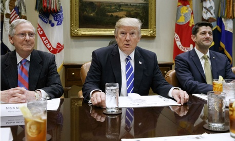 President Trump meets with Senate Majority Leader Mitch McConnell and House Speaker Paul Ryan on March 1 at the White House. Despite GOP control of Congress, disunity within the party threatens Trump's agenda.
