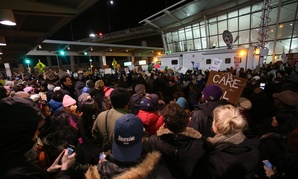 Activists protest the travel ban in January at New York's JFK Airport.