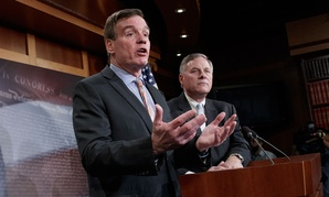 Senate Intelligence Committee Vice Chairman Sen. Mark Warner, D-Va., left, with Committee Chairman Sen. Richard Burr, R-N.C., speaks during a news conference on Capitol Hill on Wednesday.
