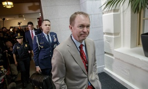 Budget Director Mick Mulvaney arrives at the Capitol on March 21.
