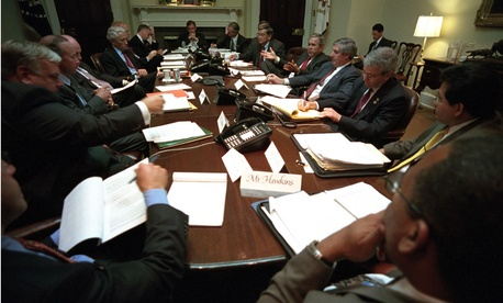 Days after the 9/11 attacks, then-President George W. Bush meets with advisers at the White House to discuss the impact of the terrorist attacks on the airline and insurance industries.