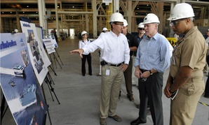 In 2009, then Navy Secretary Ray Mabus tours the Austal shipyards in Mobile, Ala., to view the progress of construction on the Navy littoral combat ships.