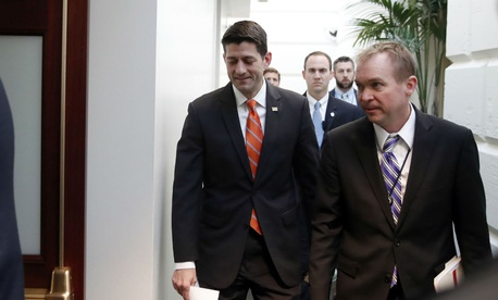 House Speaker Paul Ryan of Wis. left, and White House budget director Mick Mulvaney arrive for a meeting on Capitol Hill in March.