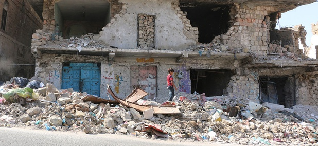 A boy walks among rubble in Taiz, Yemen in 2016.