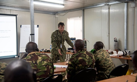 U.S. Navy Explosive Ordnance Disposal 1st Class Tyler Brooks, Task Force Sparta, teaches how to identify and counter improvised explosive devices to participants from African Union Mission in Somalia troop contributing countries in 2016.