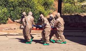 Turkish experts carry a victim of alleged chemical weapons attacks in Syrian city of Idlib.