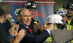 EPA Administrator Scott Pruitt holds up a hardhat he was given during a visit to Consol Pennsylvania Coal Company's Harvey Mine in Sycamore, Pa.