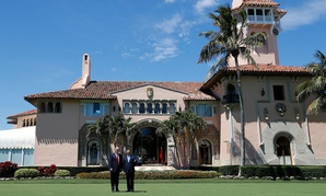 President Donald Trump and Chinese President Xi Jinping take photos at Mar-a-Lago on April 7.