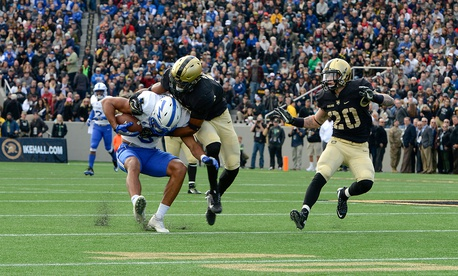 An Air Force player is tackled during the Army-Navy game in November.