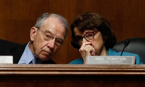 Senate Judiciary Committee Chairman Sen. Charles Grassley, R-Iowa talks with the committee's ranking member Sen. Dianne Feinstein, D-Calif. on Capitol Hill on May 3.