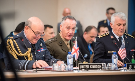 Gen. Joseph Dunford, chairman of the Joint Chiefs of Staff, meets with his counterparts during a NATO Military Committee in Chiefs of Defense session in Brussels.