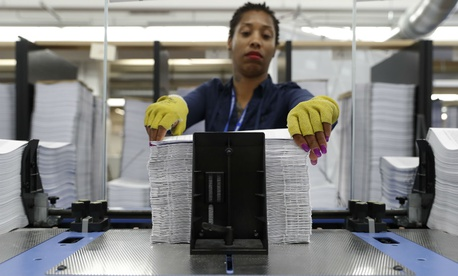 GPO worker Christina McGier straightens pages during a production run of President Donald Trump's fiscal 2018 federal budget on May 19.