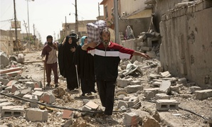 Civilians flee fighting between Iraqi special forces and Islamic State militants in Mosul.