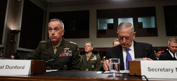 Joint Chiefs Chairman Gen. Joseph Dunford, left, and Defense Secretary Jim Mattis prepare to testify on Capitol Hill in Washington, Tuesday June 13, 2017, before the Senate Armed Services Committee.