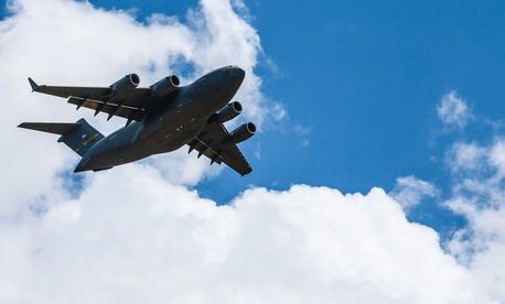 A Boeing C-17 Globemaster III flies over Sicily Drop Zone during the 82nd Airborne Divison's Airborne Review, located on Fort Bragg, N.C., May 25, 2017.