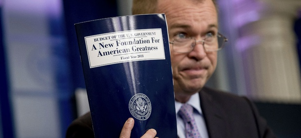 OMB Director Mick Mulvaney holds up a copy of the fiscal 2018 budget proposal. With agencies still in transition, OMB took the reins in crafting the document.