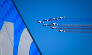 The Patrouille de France air demonstration team performs a flyby to signify the official start of the Paris Air Show on June 19.