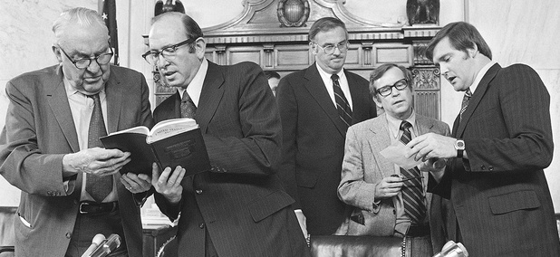 After the Senate Watergate Committee hearings concluded on Friday, August 3,1973, Senators and counsel held a session. From left are Senator Sam J. Ervin, Sam Dash, Senator Lowell P. Weicker, Senator Howard H. Baker, and the author.