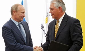 Putin and Tillerson shake hands in 2012.