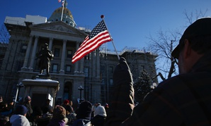 A crowd outside Denver's State Capitol protests the 2016 election result.