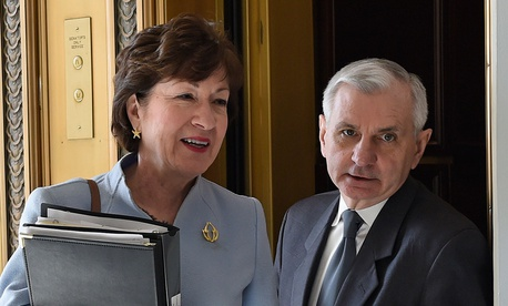 Susan Collins and Jack Reed walk together in 2015 on Capitol Hill.