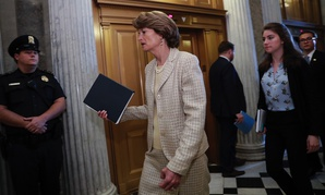 Sen. Lisa Murkowski, R-Alaska, arrives for a vote as the Republican-run Senate rejected a GOP proposal to scuttle President Barack Obama's health care law and give Congress two years to devise a replacement on Wednesday.