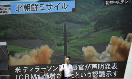 A public TV screen broadcasts a local TV news showing what was said to be the launch of a Hwasong-14 intercontinental ballistic missile, ICBM, aired by North Korea's KRT on July 4 in Tokyo.
