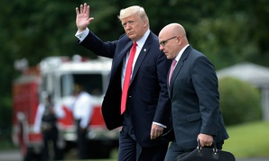 President Donald Trump waves as he walks with National Security Adviser H.R. McMaster from the Oval Office to Marine One in June.