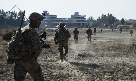 Soldiers assigned to the 10th Mountain Division walk on a dismounted patrol outside of Camp Fenty, Afghanistan in 2016.