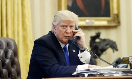 President Donald Trump speaks on the phone with Prime Minister of Australia Malcolm Turnbull on Jan. 28.