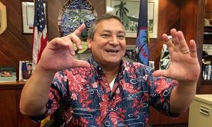 Guam Gov. Guam Eddie Baza Calvo speaks to the media in his office in Adelup, Guam on Friday.