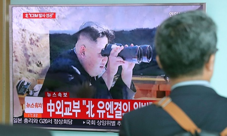 A man walks by a TV screen showing a local news program reporting about North Korea's missile firing with an image of North Korean leader Kim Jong Un, at Seoul Train Station in July.