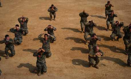 U.S. Marines assigned to Charlie Company, 1st Battalion, 3rd Marine Regiment, exercise with Republic of Korea Marines during Korean Marine Exchange Program (KMEP) 17-14 aboard the North West Islands, Republic of Korea.