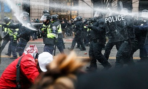 Police fire pepper spray at protestors during a demonstration in downtown Washington on Jan. 20.