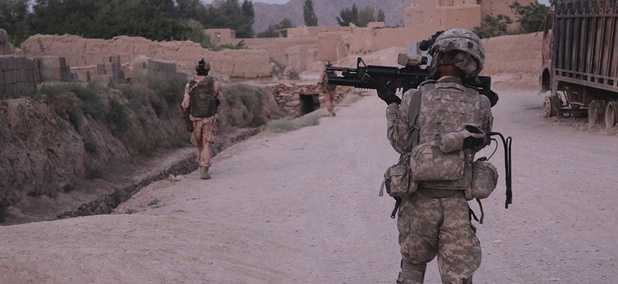 U.S. Army Sgt. 1st Class Walter Taylor, 541st Sapper Co., 54th Engineer Battalion, 18th Engineer Brigade, provides security while his team bounds forward, at Baraki Barak, Logar province, Afghanistan in 2011.