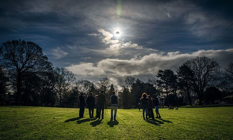 People watch a partial eclipse in Belfast, Northern Ireland in 2015.