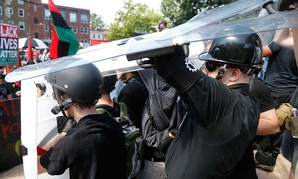 White nationalists hold shields as violence eruptsin Charlottesville on Aug. 12.