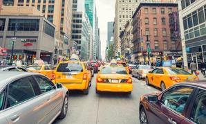 Traffic on Sixth Avenue near 38th Street in midtown Manhattan.