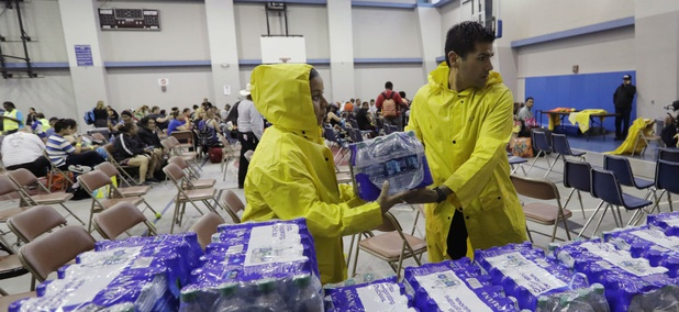 Officials deliver water to a holding area for residents waiting to be evacuated in Corpus Christi, Texas, ahead of Hurricane Harvey.