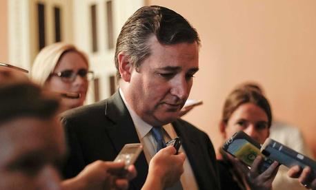 Cruz speaks to the media in July.