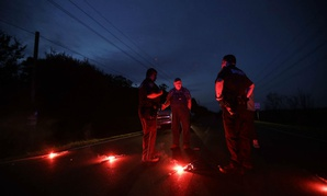 Officers at a roadblock near the Arkema chemical plant outside Houston on Aug. 31,  after the plant was rocked by multiple explosions.