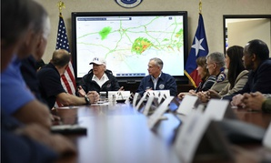 President Trump meets with personnel working at the Emergency Operations Center in Austin, Texas, Aug. 29.