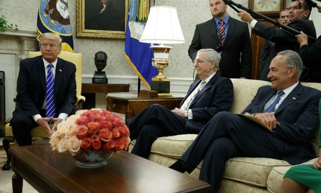 President Trump meets with congressional leaders including Senate Majority Leader Mitch McConnell (center) and Minority Leader Chuck Schumer on Wednesday. Trump sided with Democrats' plan for a three-month spending and debt limit extension.