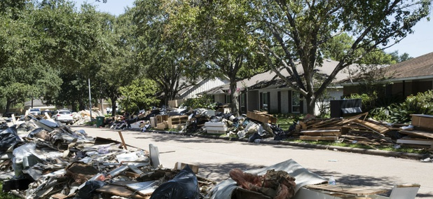 Debris damaged by flooding lines the streets after Hurricane Harvey.