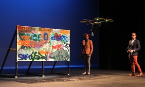 Candace Marbury and Christopher Farmer, cofounders of GRAD, demo their graffiti-cleaning drone.