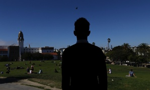 A 16-year-oldfrom Eritrea looks out overDolores Park in San Francisco. When he landed in March, he was among the last refugee foster children to make it into the U.S. before the Trump administration declared travel bans that halted thesmall, three-deca